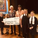 Cllr Bruce handing cheque to Chilton Academy Friends